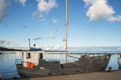 Old fishing boat at harbor of Curonian spit Stock Images