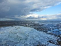 Curonian spit and ice pieces in spring, Lithuania Stock Images