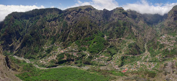 Curral das Freiras valley panorama, Madeira. Large panorama of isolated high cliff valley of Curral das Freiras. Madeira, Portugal Stock Photo