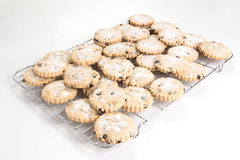 Currant/easter biscuits cooling on wire cooling rack Royalty Free Stock Photography
