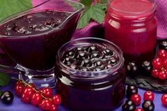 Currant jam in glass. Closeup black and red currant jam in glass stock photo
