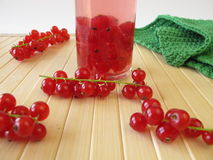 Currant liqueur. Red currant liqueur in bottle royalty free stock photography