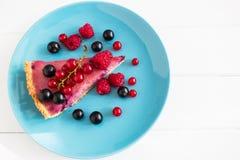Currant tart blue plate. Wedge beautiful ripe currant tart top view blue plate Royalty Free Stock Photo