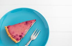 Currant tart blue plate. Wedge currant tart blue plate white wooden background Stock Photography