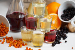 Currant wine in a bottle on wooden table. Sweet alcohol made from many varieties berry fruits Royalty Free Stock Photo