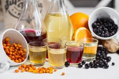 Currant wine in a bottle on wooden table. Sweet alcohol made from many varieties berry fruits Royalty Free Stock Image