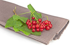Currants. Fresh red currants with leaves on a brown mat Royalty Free Stock Photo