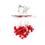 Currants splash on water, isolated on white background Royalty Free Stock Photos
