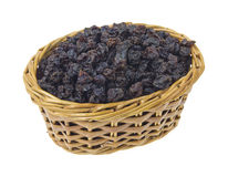 Currants in wicker basket. A small wicker basket filled with currants on a white background Stock Photo