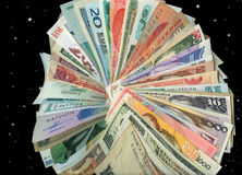 Currencies from around the world, paper banknotes. International paper currencies in motion, closeup, background, isolated Royalty Free Stock Photos