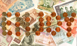 Currencies and coins from around the world. Stock Image