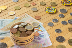 Currencies of different countries on  light brown background. Royalty Free Stock Image