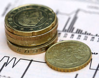 Currencies on graph Royalty Free Stock Photo