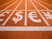 Currencies symbols on running trace start. Money concept Royalty Free Stock Photos