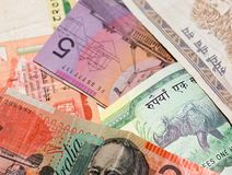 Currencies of the world. A bunch of notes from different countries. Can be used for themes such as wealth, investment, money, foreign currency exchange Stock Photography