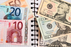 Currency. The American and European money in a exercise book Stock Image