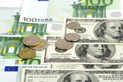 Currency background. Dollars and euro with coins background royalty free stock photo