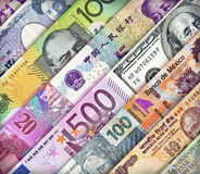 Currency Background Background. Different currency bills creating a colorful background Stock Photo