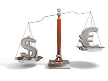 Currency on balance scale Royalty Free Stock Photo