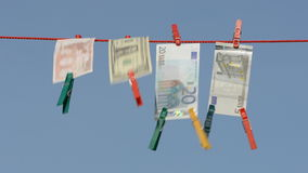 Currency banknote on clothes-line after money-laundering Royalty Free Stock Photos