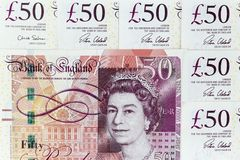 Currency banknotes spread across frame british pound sterling. Notes royalty free stock image