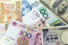Currency banknotes spread across frame including world major currencies. Notes Stock Image