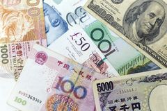 Currency banknotes spread across frame including world major currencies. Notes Royalty Free Stock Photography