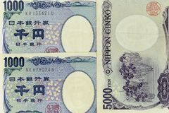 Currency banknotes spread across frame japanese yen in various denomination royalty free stock image