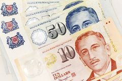 Currency banknotes spread across frame singapore dollar in various denomination. Notes Royalty Free Stock Image