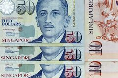 Currency banknotes spread across frame singapore dollar in various denomination. Notes Stock Images