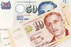 Currency banknotes spread across frame singapore dollar in various denomination. Notes Royalty Free Stock Images
