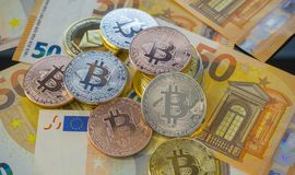 Currency Bitcoin BTC coins on bills of euro banknotes. Worldwide Stock Photography