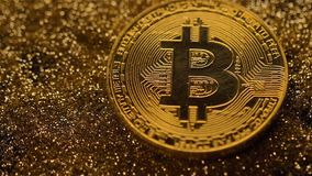 Currency Bitcoin Falls down on Gold Sparklets Macro. Macro fantastic famous electronic currency bitcoin real model falls down on gold sparklets pile stock video