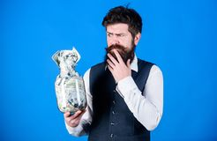 Currency broker with large money sum. Businessman keeping paper currency in glass jar. Hipster holding american dollar. Currency deposit. Foreign currency is royalty free stock photos