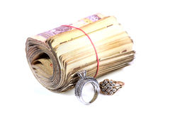 Currency bundle and rings Royalty Free Stock Images