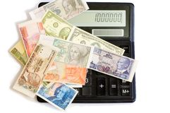 Currency and calculator. The currency of the different countries and calculator Stock Photo