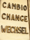 Currency change. A sign for currency change in three languages: italian, englishand german. photo taken in an italian city Stock Photography