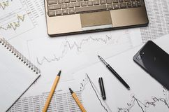 Currency charts and broker financial reports on paper stock photos