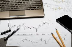 Currency charts on paper, Forex profit calculation, broker workplace royalty free stock photos
