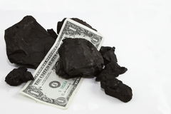 Currency And Coal Chunks Stock Photo