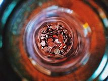 Currency. Coins in a glass bottle Royalty Free Stock Photo