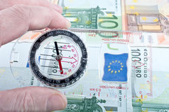 Currency and compass Royalty Free Stock Image