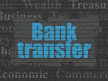 Currency concept: Bank Transfer on wall background. Currency concept: Painted blue text Bank Transfer on Black Brick wall background with  Tag Cloud Stock Images