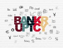 Currency concept: Bankruptcy on wall background. Currency concept: Painted multicolor text Bankruptcy on White Brick wall background with  Hand Drawn Finance Royalty Free Stock Photo