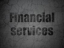 Currency concept: Financial Services on grunge wall background. Currency concept: Black Financial Services on grunge textured concrete wall background Royalty Free Stock Images