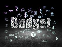 Currency concept: Budget in grunge dark room. Currency concept: Glowing text Budget,  Hand Drawn Finance Icons in grunge dark room with Dirty Floor, black Royalty Free Stock Photos