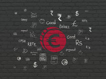 Currency concept: Euro Coin on wall background. Currency concept: Painted red Euro Coin icon on Black Brick wall background with  Hand Drawn Finance Icons Royalty Free Stock Photo