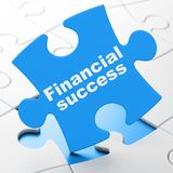 Currency concept: Financial Success on puzzle background. Currency concept: Financial Success on Blue puzzle pieces background, 3D rendering Stock Photo