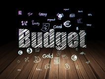 Currency concept: Budget in grunge dark room. Currency concept: Glowing text Budget,  Hand Drawn Finance Icons in grunge dark room with Wooden Floor, black Stock Image