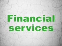 Currency concept: Financial Services on wall background. Currency concept: Green Financial Services on textured concrete wall background Stock Images